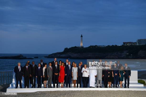 TOPSHOT G7 leaders and guests pose for a family picture with the Biarritz lighthouse in the background on the second day of the annual G7 summit in...
