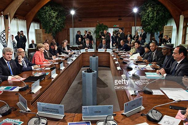 G7 leaders and outreach guests including Germany's Chancellor Angela Merkel and United States President Barack Obama attend a working session with at...