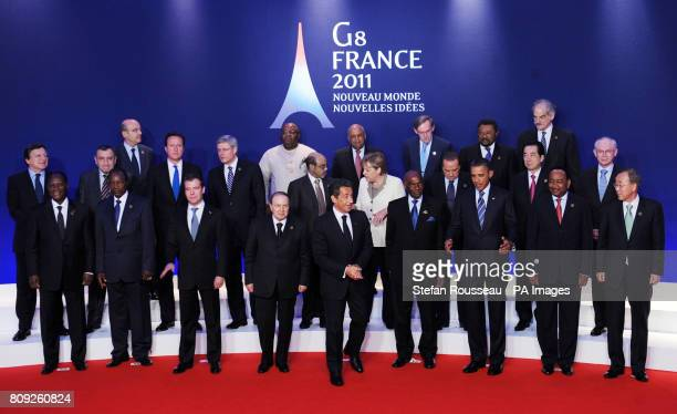 G8 leaders and outreach leaders pose for a 'family photograph' after attending a meeting to discuss peace and security in Africa on the second day of...