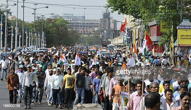 TMC leaders and party workers protest rally against heckling of West Bengal Finance Minister Amit Mitra in Delhi on April 13 2013 in Kolkata India...