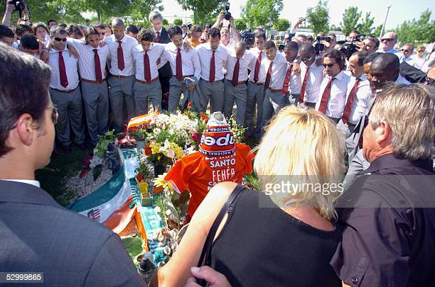 Leaders and players of champion football team Portuguese Benfica pray with the perents in front of their late teammate Miklos Feher's grave in the...