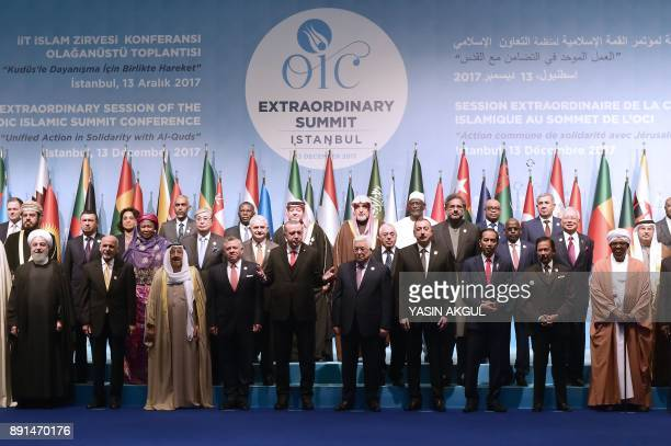 Leaders and representatives of member states pose for a group photo during an Extraordinary Summit of the Organisation of Islamic Cooperation on last...
