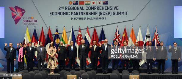 Leaders and representatives pose for a group photo during the 2nd Regional Comprehensive Economic Partnership summit on the sidelines of the 33rd...
