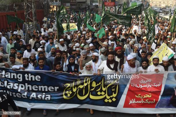 Leaders and supporters of TehreekeLabaik Ya Rasool Allah a hardline religious party march during a protest in Lahore on October 19 demanding for...