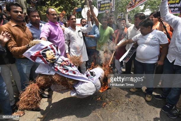 BJP leaders and workers burn an effigy of West Bengal CM Mamata Banerjee protesting against the murder of the 21yearold BJP worker Trilochan Mahato...