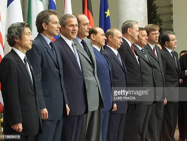 Leaders at the G-8 economic summit including Japanese Prime Minister Junichiro Koizumi, British Prime Minister Tony Blair, US President George W....