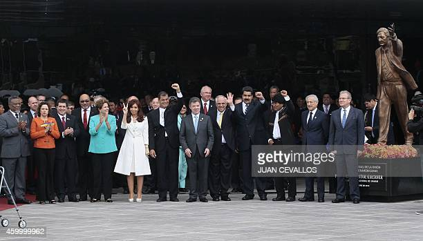 Leaders from South American bloc UNASUR pose after unveiling a statue in honour of late Argentine President Nestor Kirchner during the inauguration...