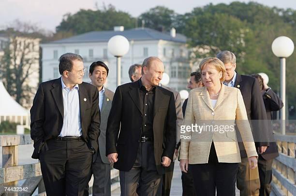G8 leaders Italian Prime Minister Romano Prodi Russian President Vladimir Putin Japanese Prime Minister Shinzo Abe German Chancellor Angela Merkel...