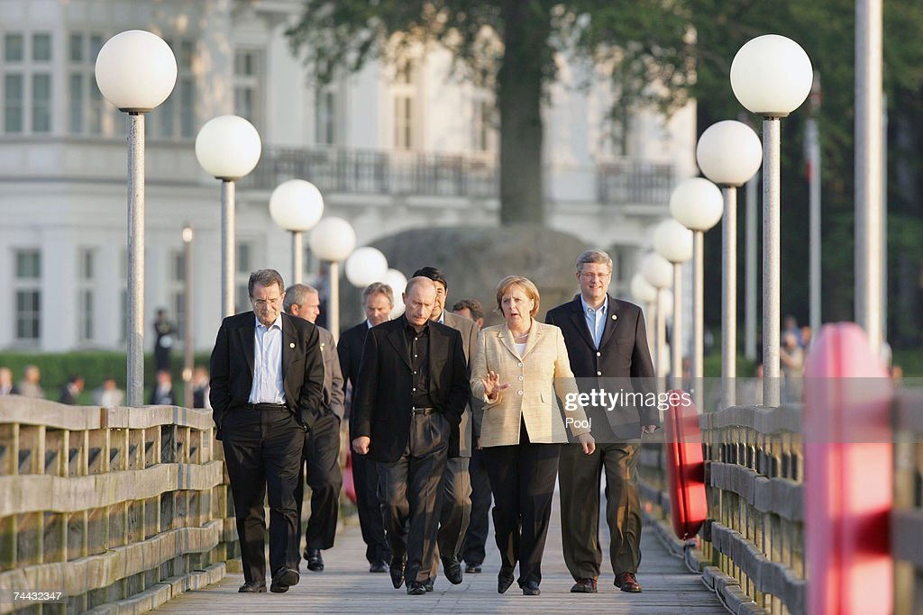 G8 leaders (L-R) Italian Prime Minister Romano Prodi, Russian President Vladimir Putin, Japanese Prime Minister Shinzo Abe, German Chancellor Angela Merkel and Canadian Prime Minister Stephen Harper walk on the sea front pier on May 7, 2007 in Heiligendamm, Germany. G8 world leaders are holding their first full day of talks today.