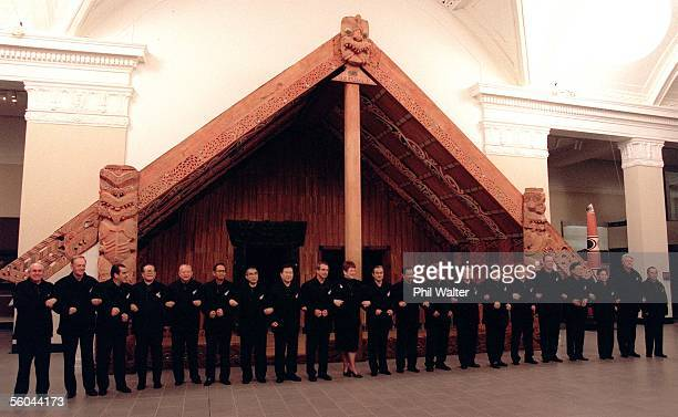 APEC leaders line up for the offical photograph in front of a Maori meeting house in the Auckland Museum Monday