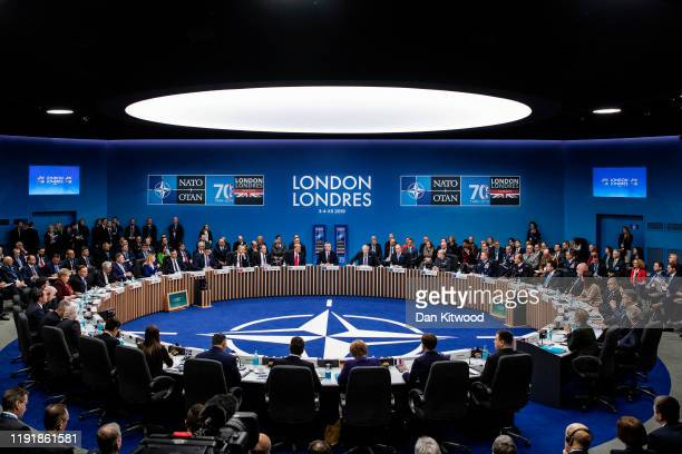 NATO leaders listen to UK Prime Minister Boris Johnson while attending their summit at the Grove Hotel on December 4 2019 in Watford England France...