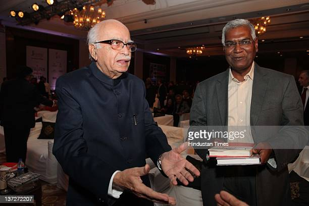 BJP leaders LK Advani and CPI leader D Raja attend the 'Ramnath Goenka Excellence in Journalism Awards 20102011' on January 16 2012 in New Delhi...