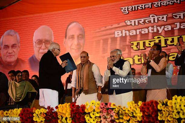 BJP leaders LK Advani Rajnath Singh and Narendra Modi during the party's national council meeting at Ramlila ground on January 19 2014 in New Delhi...