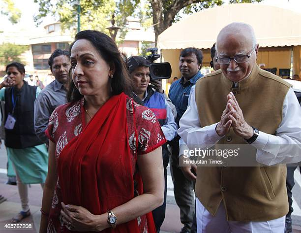 BJP leaders LK Advani with Hema Malini at Parliament House during budget session on March 10 2015 in New Delhi India Facing stiff opposition over the...