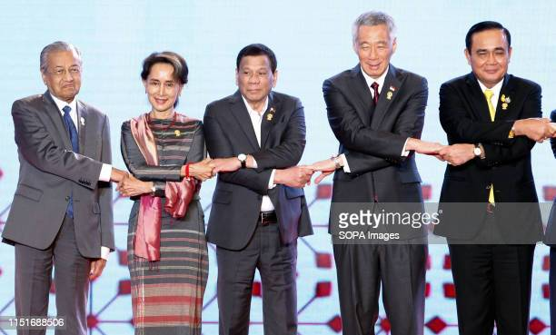 ASEAN leaders Malaysia's Prime Minister Mahathir Bin Mohamad State Counsellor of The Republic of The Union of Myanmar Aung San Suu Kyi President of...
