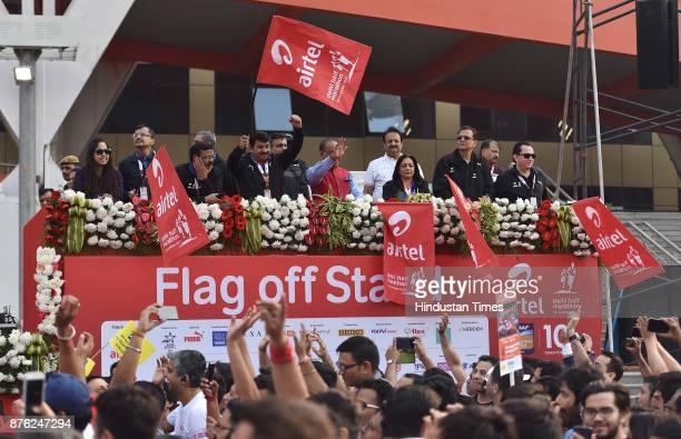 BJP leaders Manoj Tiwari along with Vijay Goel among others during the Airtel Delhi Half Marathon 2017 at JLN Stadium on November 19 2017 in New...