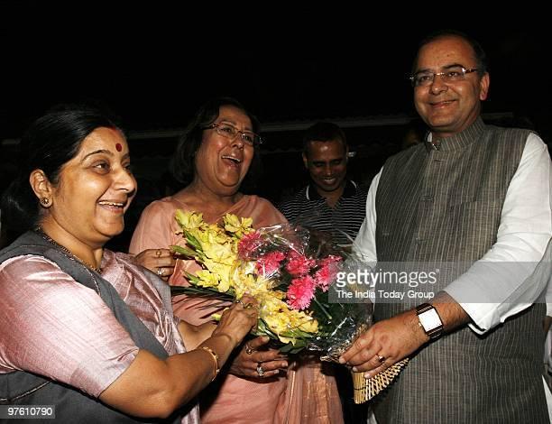 BJP leaders Najma Heptullah Sushma Swaraj celebrating with Arun Jaitley outside Parliament after Rajya Sabha passes Women's Reservation Bill on...