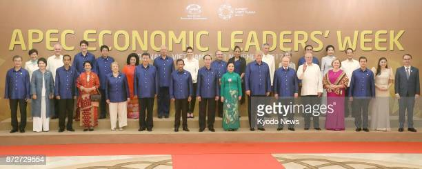 Leaders of 21 Pacific Rim economies pose for a photo at the AsiaPacific Economic Cooperation forum summit in the central Vietnamese city of Danang on...