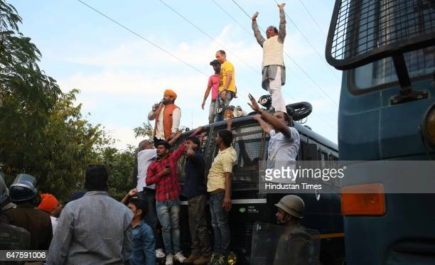 Leaders of a rally try to pacify their aggressive protestors from various social organisations demanding reservation for economically weaker generals...