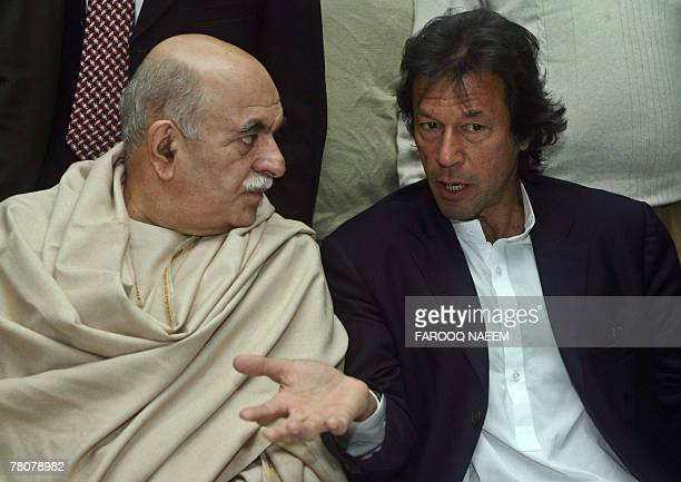 Leaders of All Parties Democratic Movement Alliance Asfandyar Wali talks with politician and former cricketer Imran Khan after an APDMA meeting in...