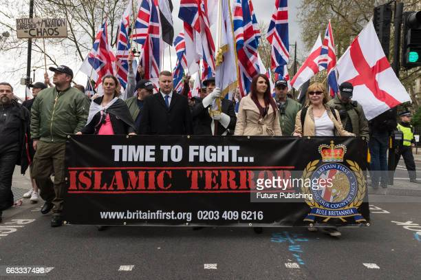 Leaders of Britain First Jayda Fransen and Paul Golding lead March Against Terrorism on April 01 2017 in London England Supporters of farright...