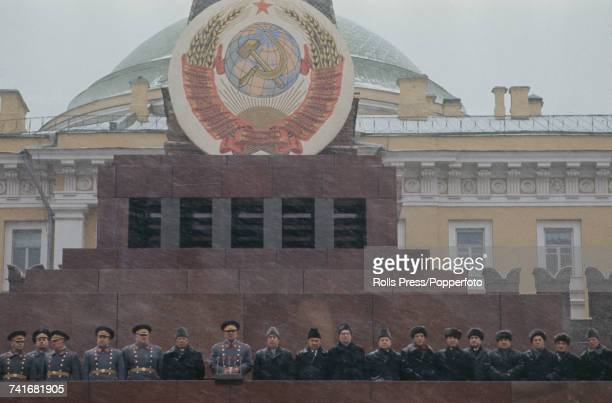 Leaders of Communist Party of the Soviet Union and Red Army generals stand together on the rostrum above Lenin's mausoleum to view the annual...