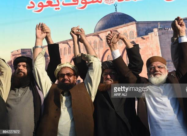 Leaders of DifaePakistan Council raise hands during an antiUS and Israel rally in Lahore on December 17 following US President Donald Trump's...