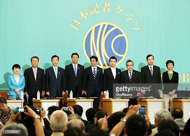Leaders of Japan's political parties pose for a group photograph ahead of a debate at the Japan National Press Club in Tokyo Japan on Wednesday July...