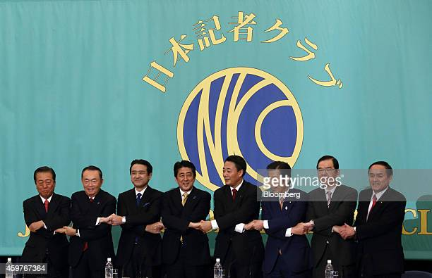 Leaders of Japan's political parties pose for a group photograph before their debate ahead of the Dec 14 election at the Japan National Press Club in...