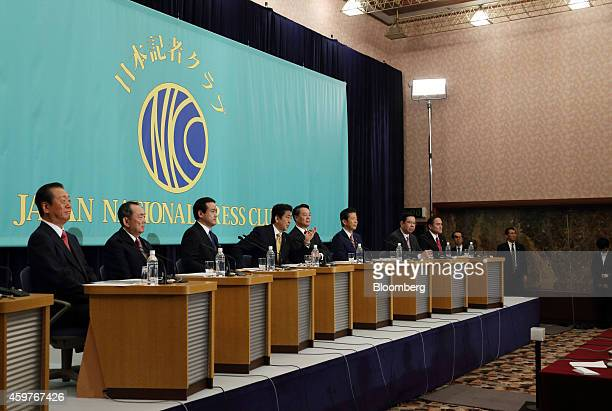 Leaders of Japan's political parties take part in a debate ahead of the Dec 14 election at the Japan National Press Club in Tokyo Japan on Monday Dec...