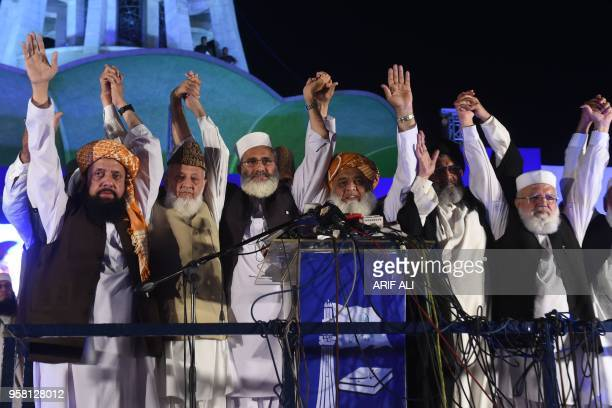 Leaders of Muttahida MajliseAmal a religious parties alliance raise hands in solidarity during a public meeting in Lahore on May 13 in the connection...