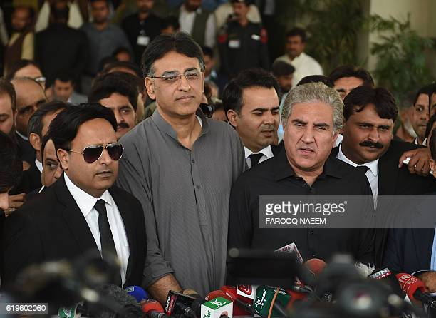 Leaders of of the Pakistan TehreekiInsaf political party Shah Mehmood Qureshi and Asad Umar talk to media outside the Supreme Court building during a...