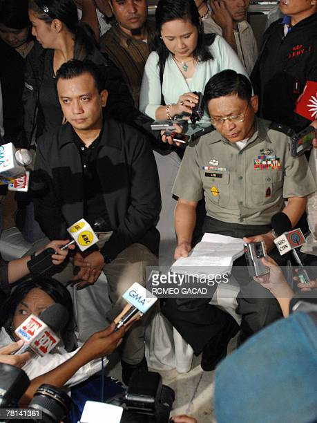 Leaders of Philippine rebel soldiers Senator Antonio Trillanes and Army BrigadierGeneral Danilo Lim hold a press conference after rebel soldiers took...