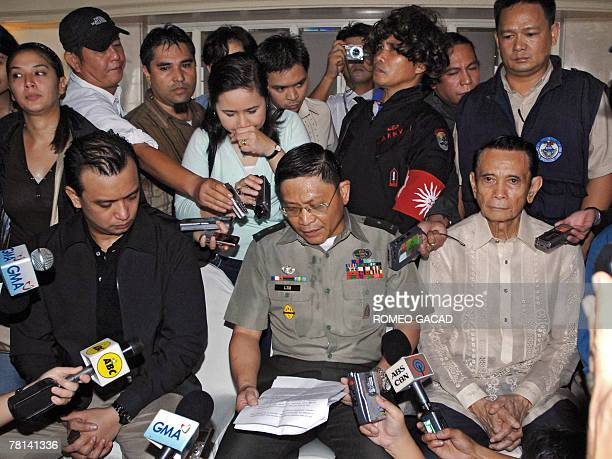Leaders of Philippine rebel soldiers Senator Antonio Trillanes Army BrigadierGeneral Danilo Lim and former vice president Teofisto Guingona hold a...
