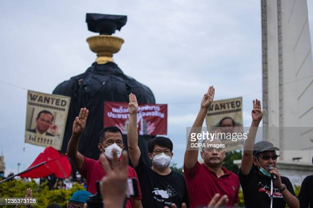 Leaders of red shirts group raise three finger salute at the democracy monument during the demonstration. The pro-democracy protesters gathered at...