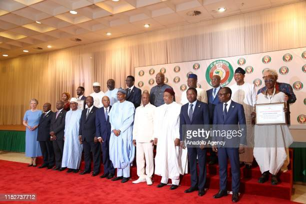 Leaders of the Economic Community of West African States pose for a family photo during the 55th Ordinary Session of the Economic Community of West...