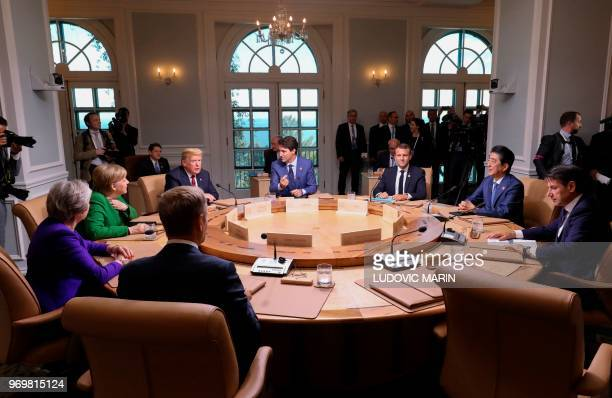 Leaders of the G7 participate in a working session of the G7 Summit in La Malbaie Quebec Canada June 8 2018 Seated clockwise from left German...