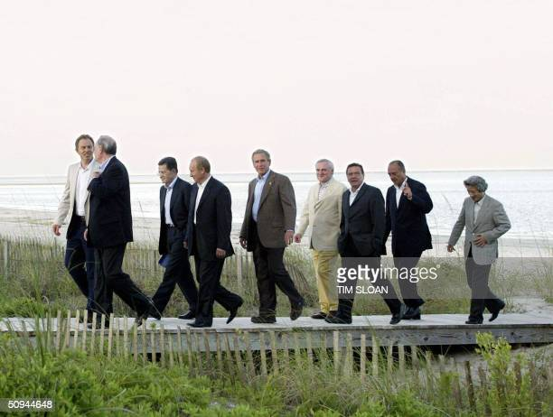 Leaders of the Group of Eight Summit stroll on the beach of Sea Island 09 June 2004 in the southeastern coastal state of Georgia From left are...