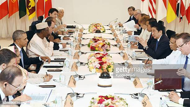 Leaders of the Group of Seven major economies and their counterparts from Indonesia, Laos, Vietnam as well as four other non-G-7 countries attend an...