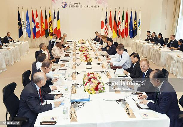Leaders of the Group of Seven major economies and their counterparts from Indonesia Laos Vietnam as well as four other nonG7 countries attend an...