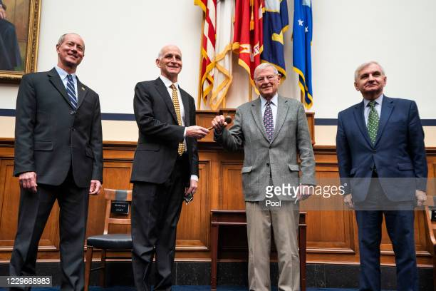 Leaders of the House and Senate Armed Services Committees U.S. Rep. Adam Smith and Sen. James Inhofe participate in a ceremonial gavel passing while...
