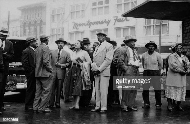 Leaders of the Montgomery bus boycott stand at a bus stop and wait for a bus following the end of the yearlong protest Montgomery Alabama December 26...