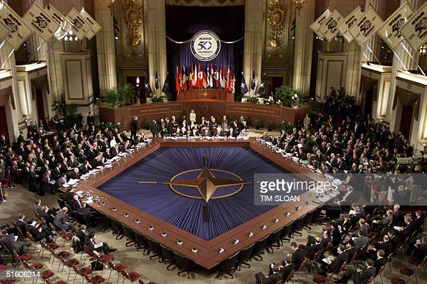 Leaders of the NATO and the countries bordering Kosovo gather around the pentagonal meeting table at the third day of the NATO Summit 25 April, 1999...