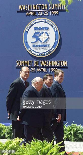 Leaders of the NATO nations pass by the NATO Emblem following plenary meetings on the second day of the NATO Summit 24 April in Washington DC From L...