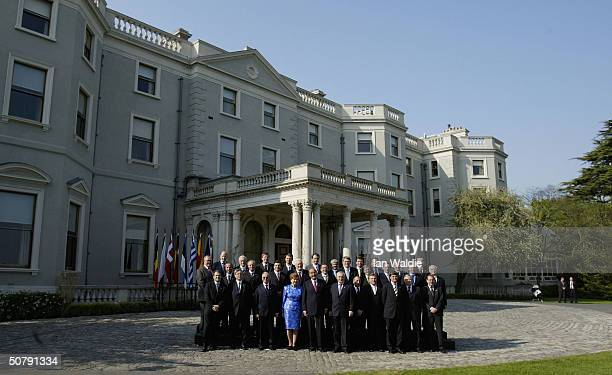 Leaders of the new European Union member states pose for a group photo during the Day of Welcomes ceremony May 1 2004 in Dublin They are Bulgaria's...