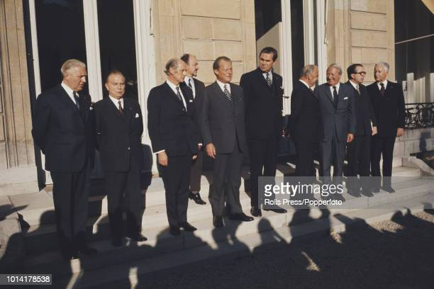 Leaders of the nine member nations of the European Common Market pose together on the steps of the Elysee Palace after sitting down at a conference...