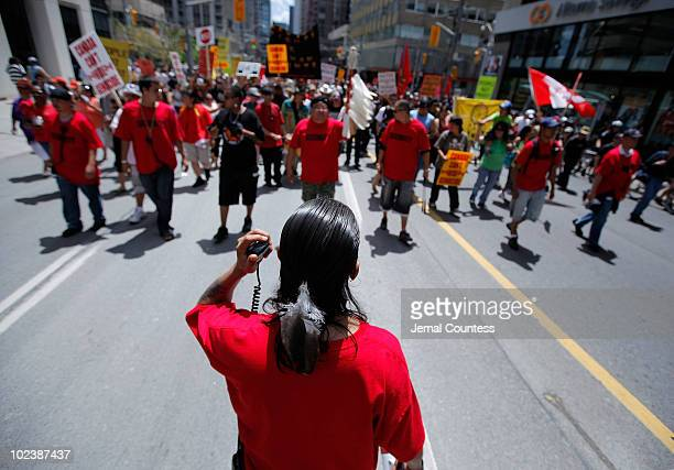 Leaders of the organization Defenders of the Land lead a march of several hundred indigenous people on a march through the streets of Toronto to...