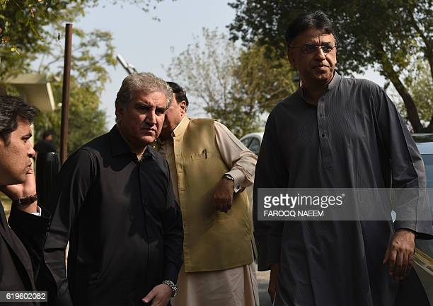 Leaders of the Pakistan TehreekiInsaf political party Shah Mehmood Qureshi and Asad Umar leave the Supreme Court building during a break in the case...