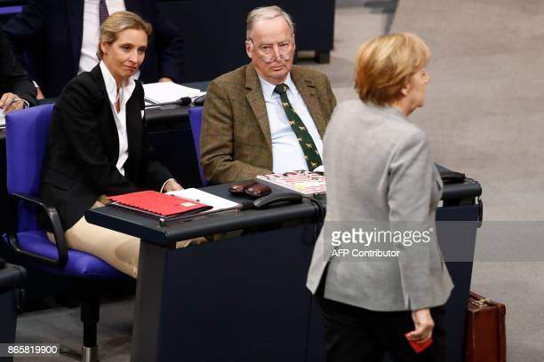 TOPSHOT Leaders of the parliamentary group of the farright party Alternative for Germany Alexander Gauland and Alice Weidel look on as German...