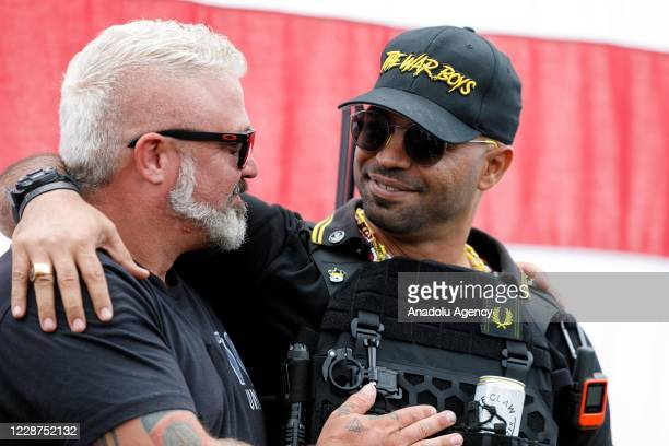 Leaders of the Proud Boys a rightwing proTrump group Enrique Tarrio and Joe Biggs salute each other as the Proud boys members gather with their...